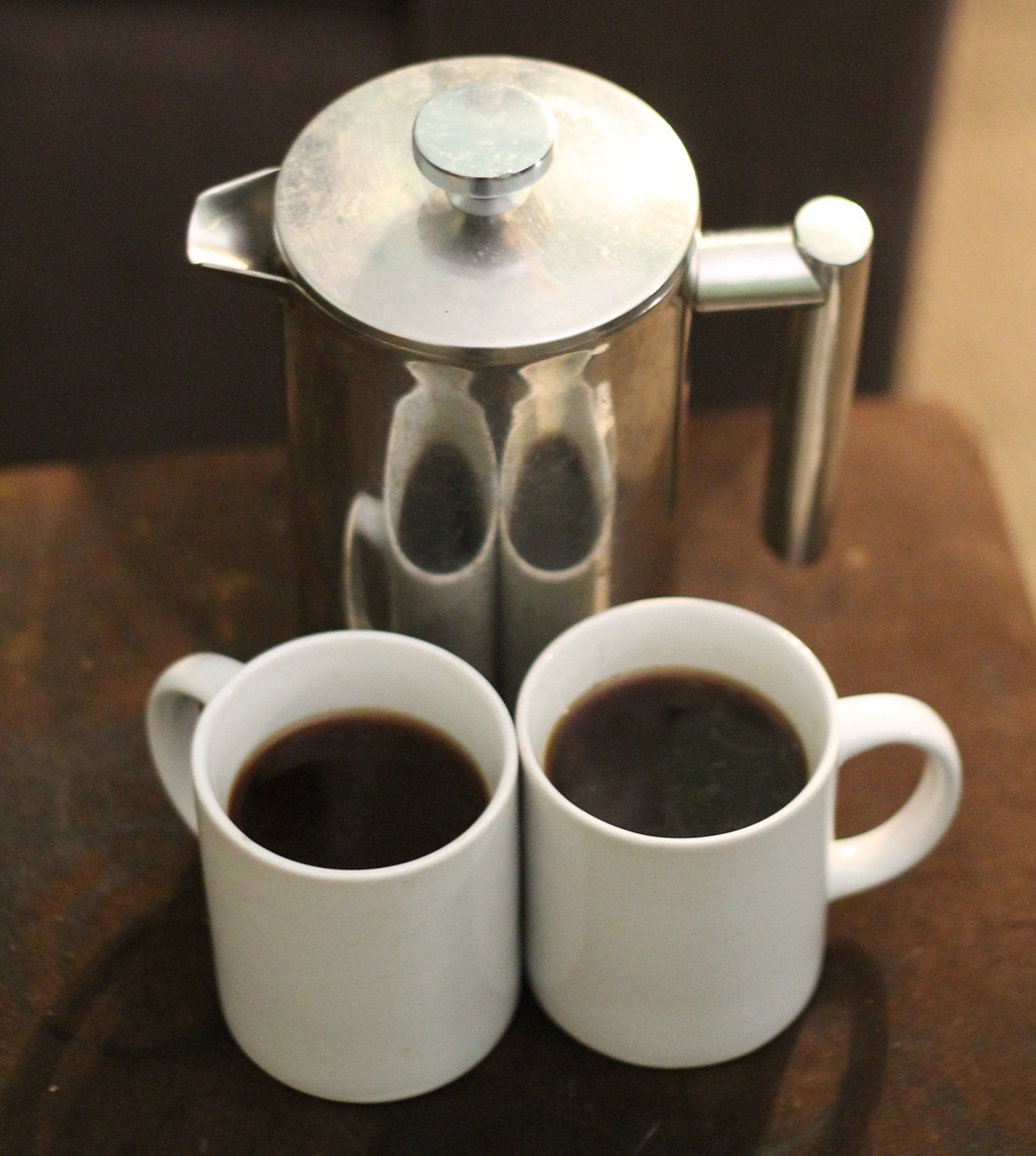 Two mugs of coffee and french press